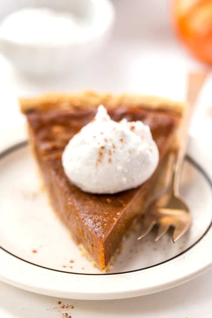 PERFECT Vegan Pumpkin Pie served in a flakey, grain-free almond flour crust!