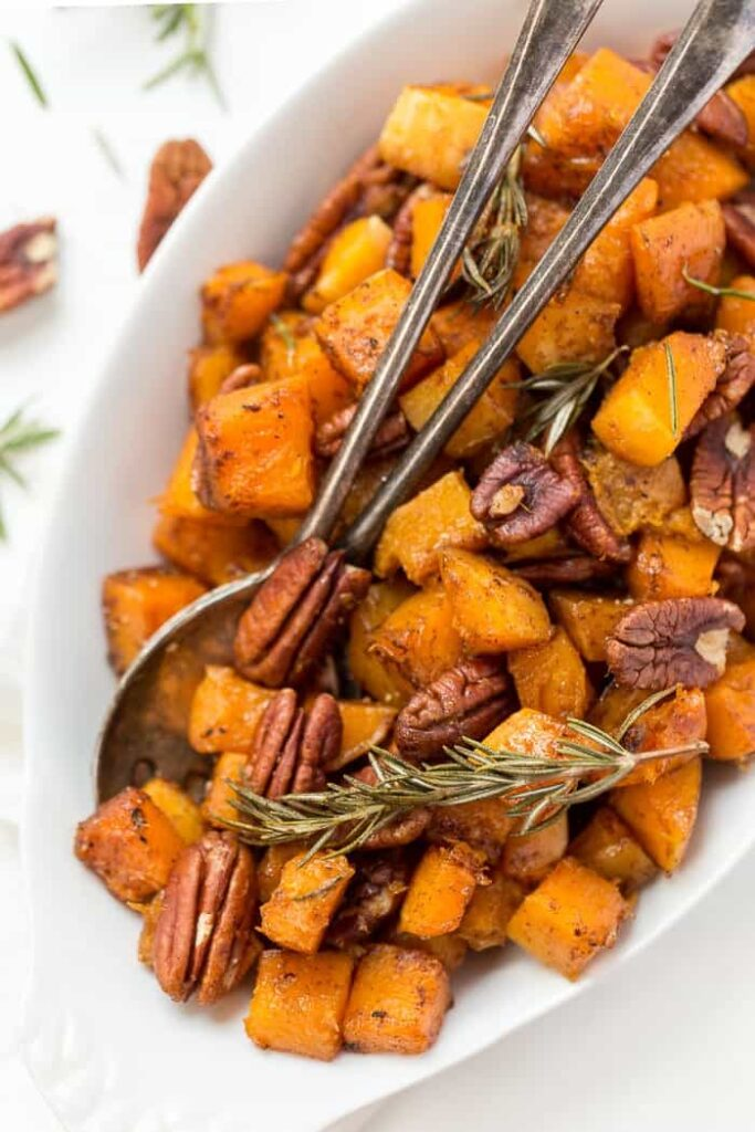 This Maple Roasted Butternut Squash is a PERFECT holiday side dish! Just 7 ingredients, one bowl and 40 minutes to make!