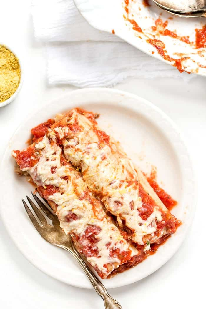 This PERFECT Vegan Manicotti is made with a creamy tofu ricotta and topped with a homemade tomato sauce!