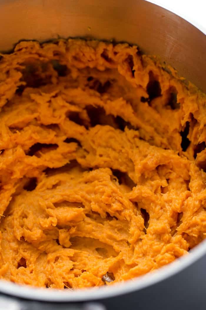 Mashed sweet potatoes in a bowl.