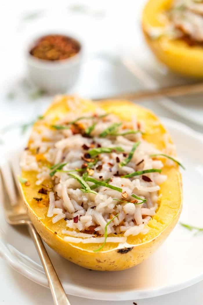 Vegetarian Spaghetti Squash Boats -- ready in 30 minutes and filled with an easy vegan bolognese sauce!