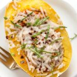 30 MINUTE Vegetarian Spaghetti Squash Boats -- packed with a delicious red lentil bolognese sauce!