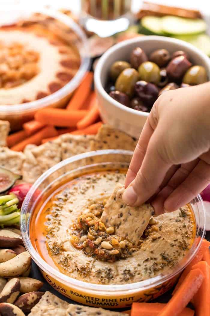 vegan snack board with hummus and olives