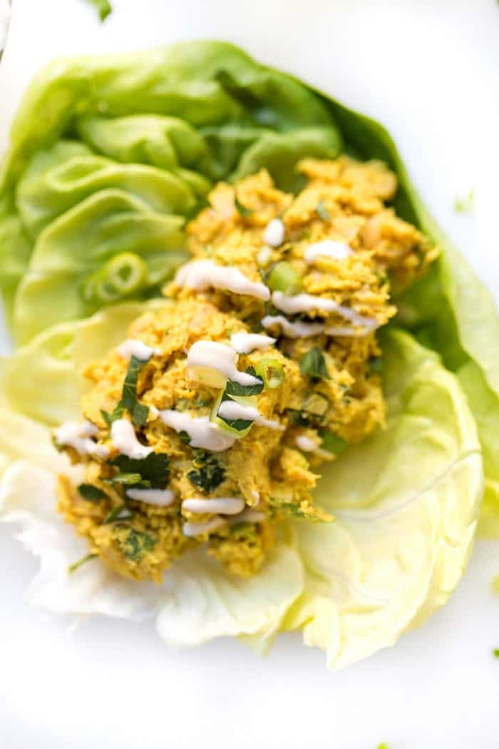 smashed curry chickpea salad served in a lettuce wrap