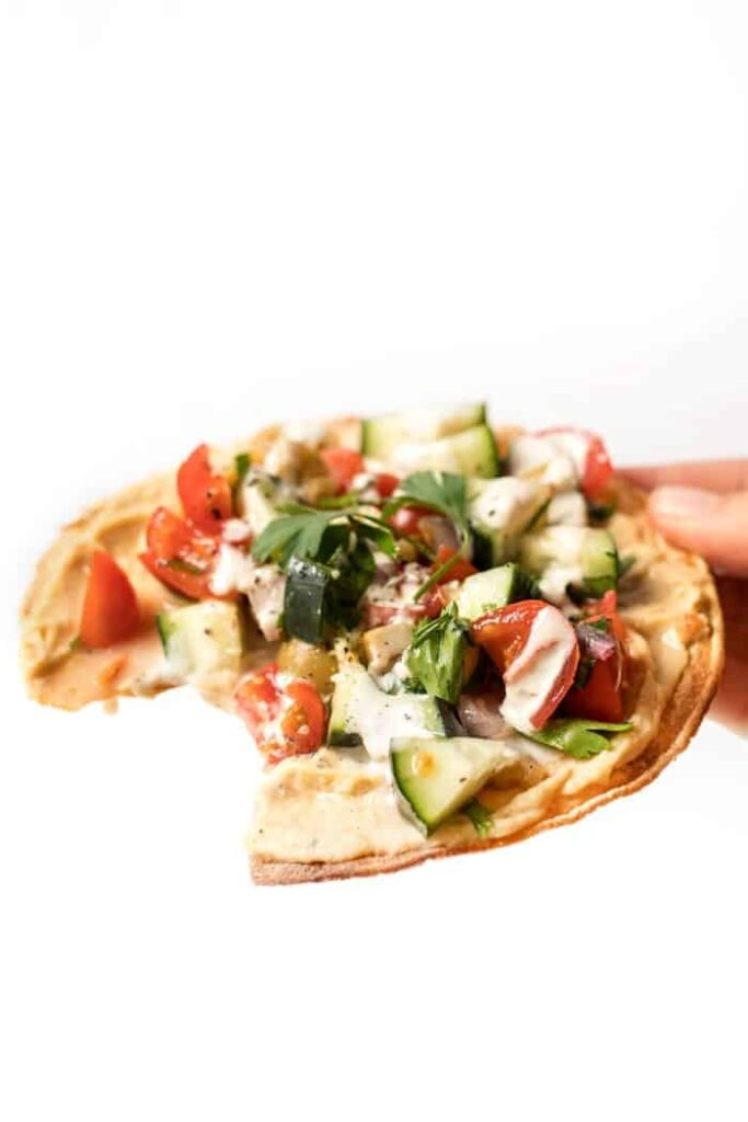 vegan tostadas with mediterranean salad and hummus