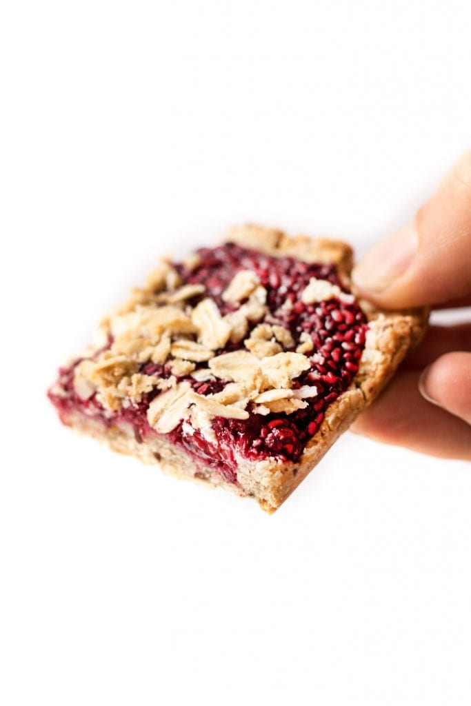 vegan raspberry oatmeal bars made with just 9 ingredients