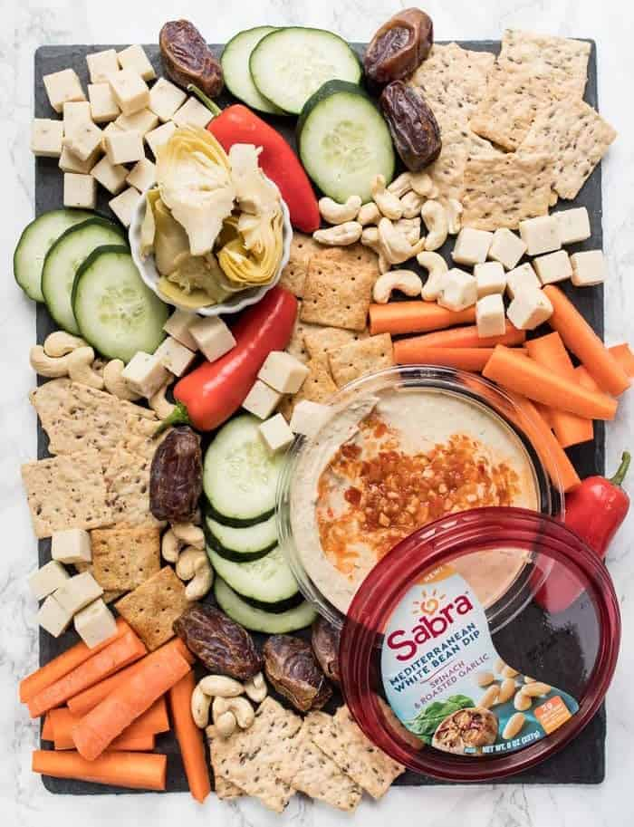 healthy vegan snack board with white bean dip