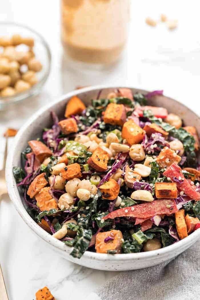 superfood kale salad with spicy thai almond butter sauce