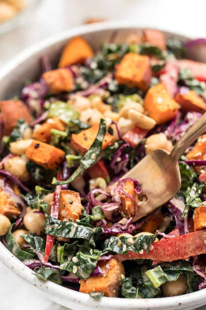 superfood kale salad with a creamy almond butter dressing