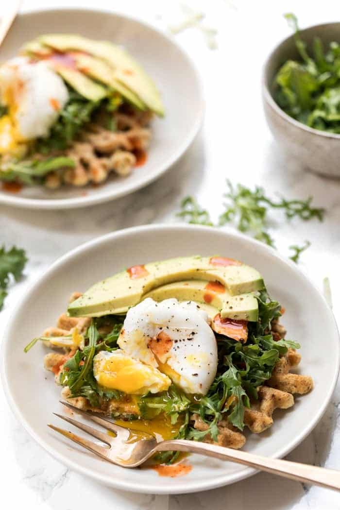 zucchini almond flour waffles with hummus and arugula