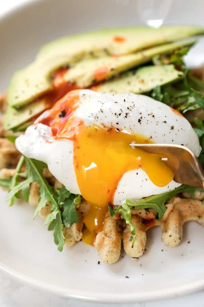 gluten-free almond flour waffles with hummus and poached eggs