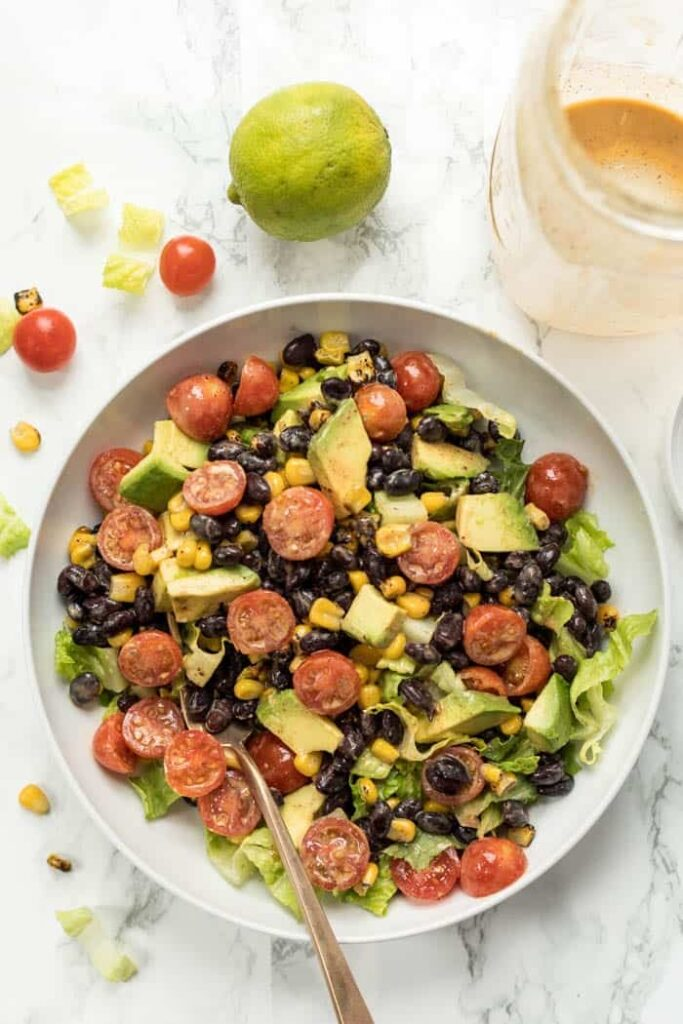 healthy vegetarian taco salads with black beans, romaine and avocado