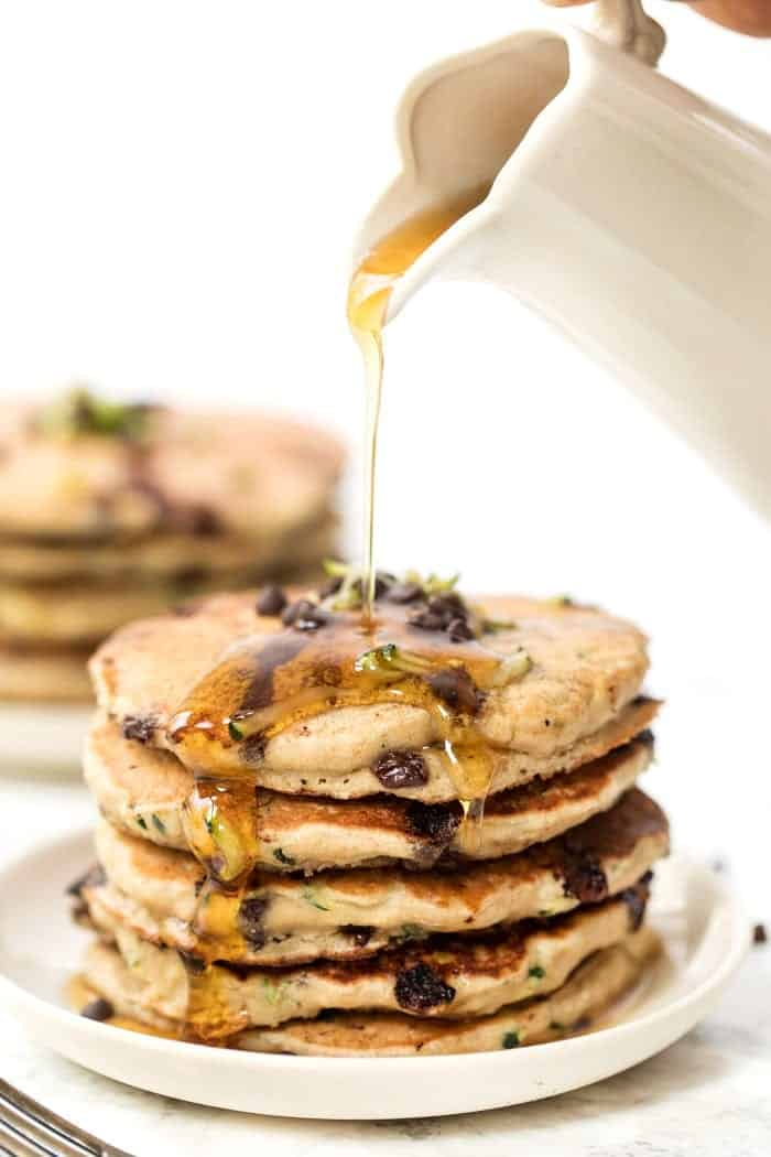 Pouring Maple Syrup on Healthy Pancakes