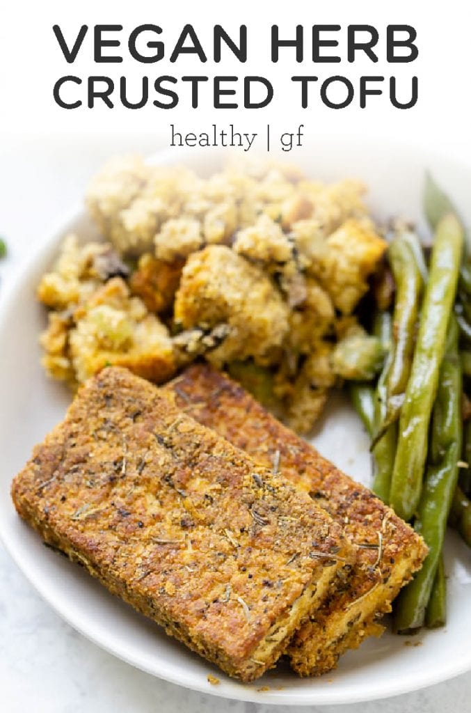 This Vegan Herb Crusted Tofu makes a delicious vegetarian entree or side dish for a crowd at Thanksgiving! This easy homemade recipe is made with quinoa flour, nutritional yeast, garlic and healthy seasonings and spices!