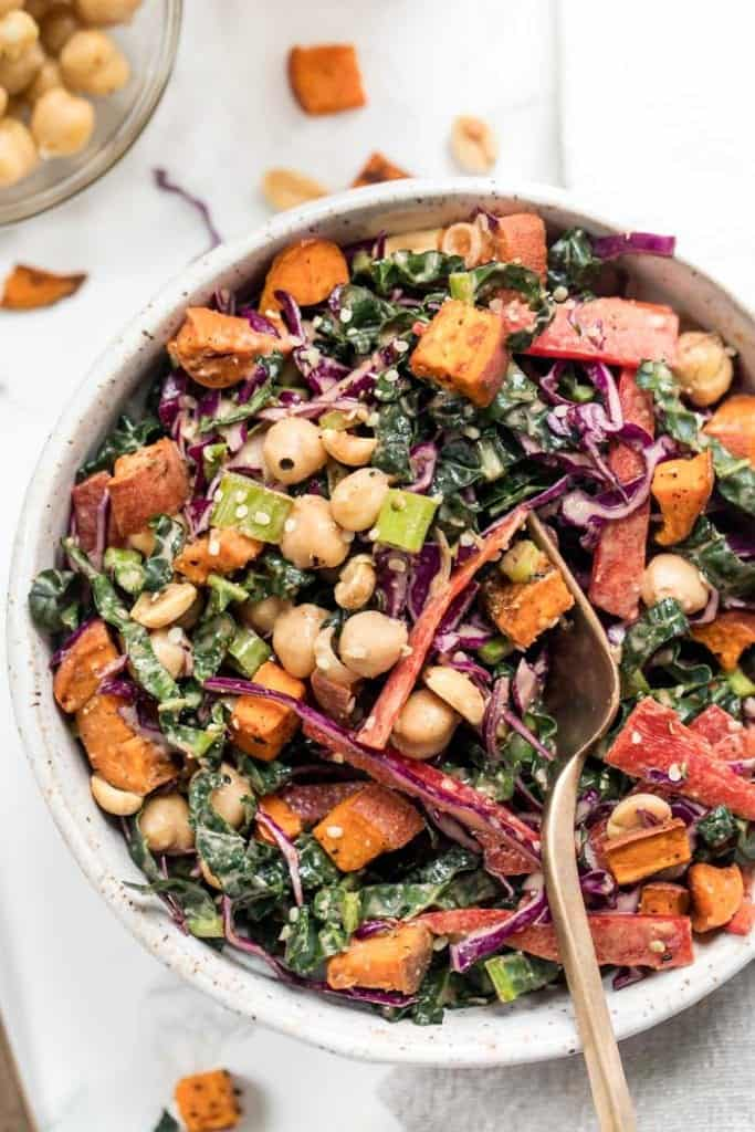 easy superfood kale salad with thai almond butter dressing