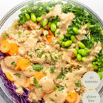 overhead glass bowl asian quinoa salad with dressing