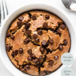 overhead of white bowl with blended baked oatmeal and chocolate chips