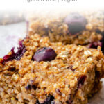 close up on a cut blueberry breakfast bar with fresh blueberries and quinoa