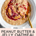 overhead of a bowl of creamy oatmeal with peanut butter, jelly and coconut on top