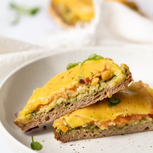 side view of a halved vegan chickpea melts with pesto