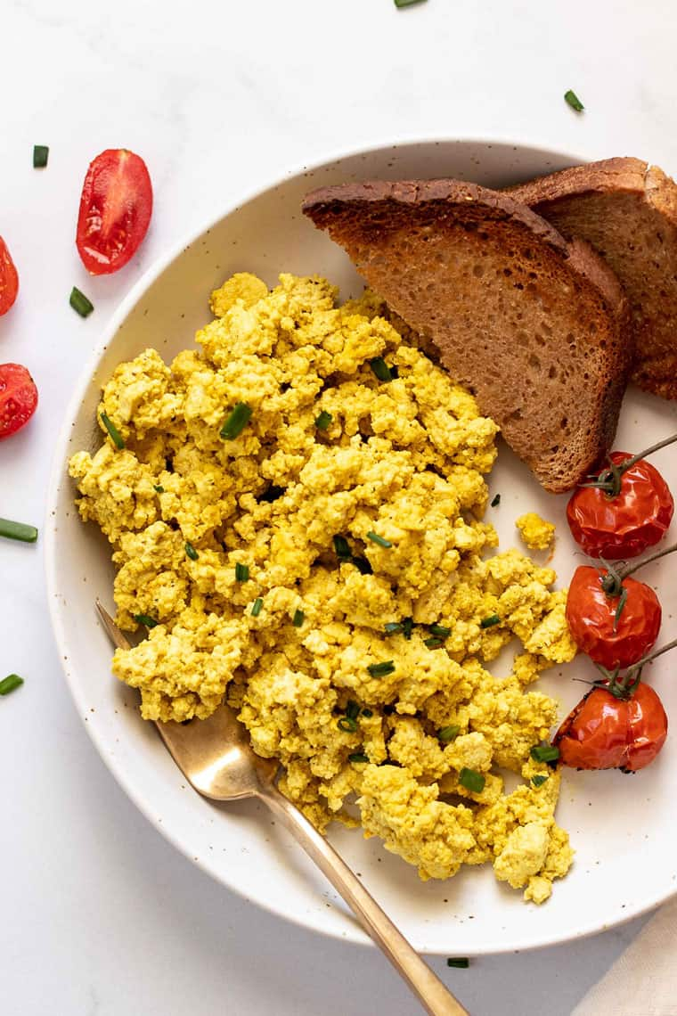 easy tofu scramble recipe with roasted tomatoes and toast on the side
