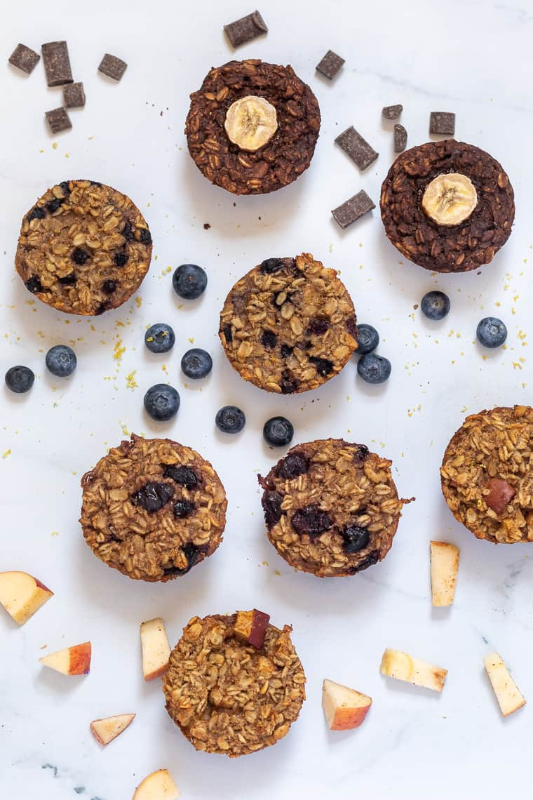 overhead of 4 flavors of baked oatmeal cups that are vegan and gluten-free