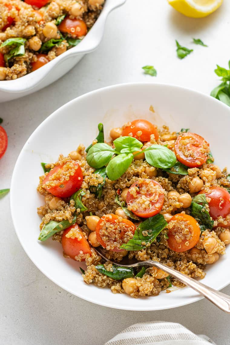 45 degree overhead of quinoa caprese salad with tomatoes and basil