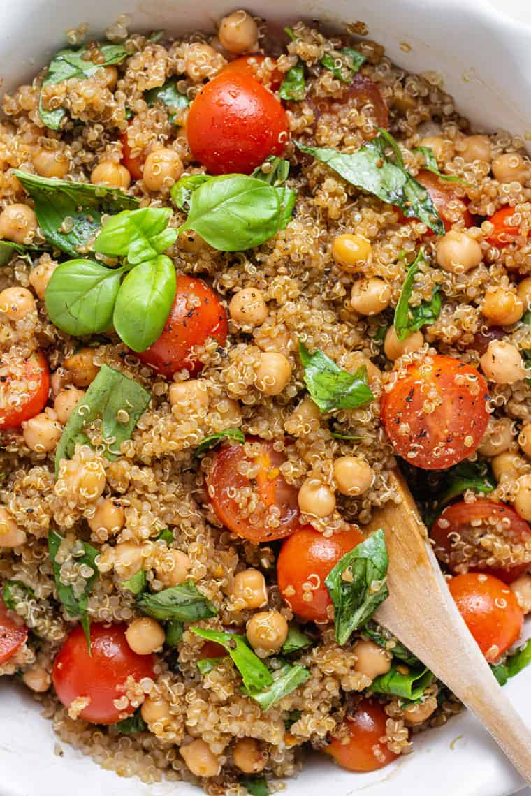 close up on detail of quiona salad with tomatoes, basil and balsamic dressing
