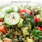 close up on quinoa tabbouleh salad with tomatoes and cucumbers
