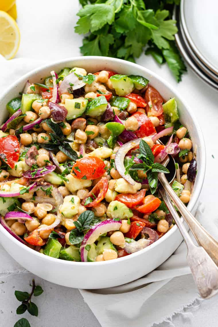 bowl of colorful chickpea and vegetable salad with dijon dressing