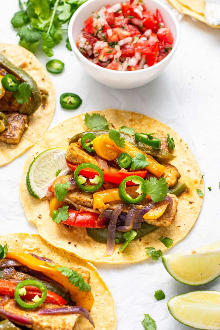overhead of a fajita made with tempeh and bell peppers
