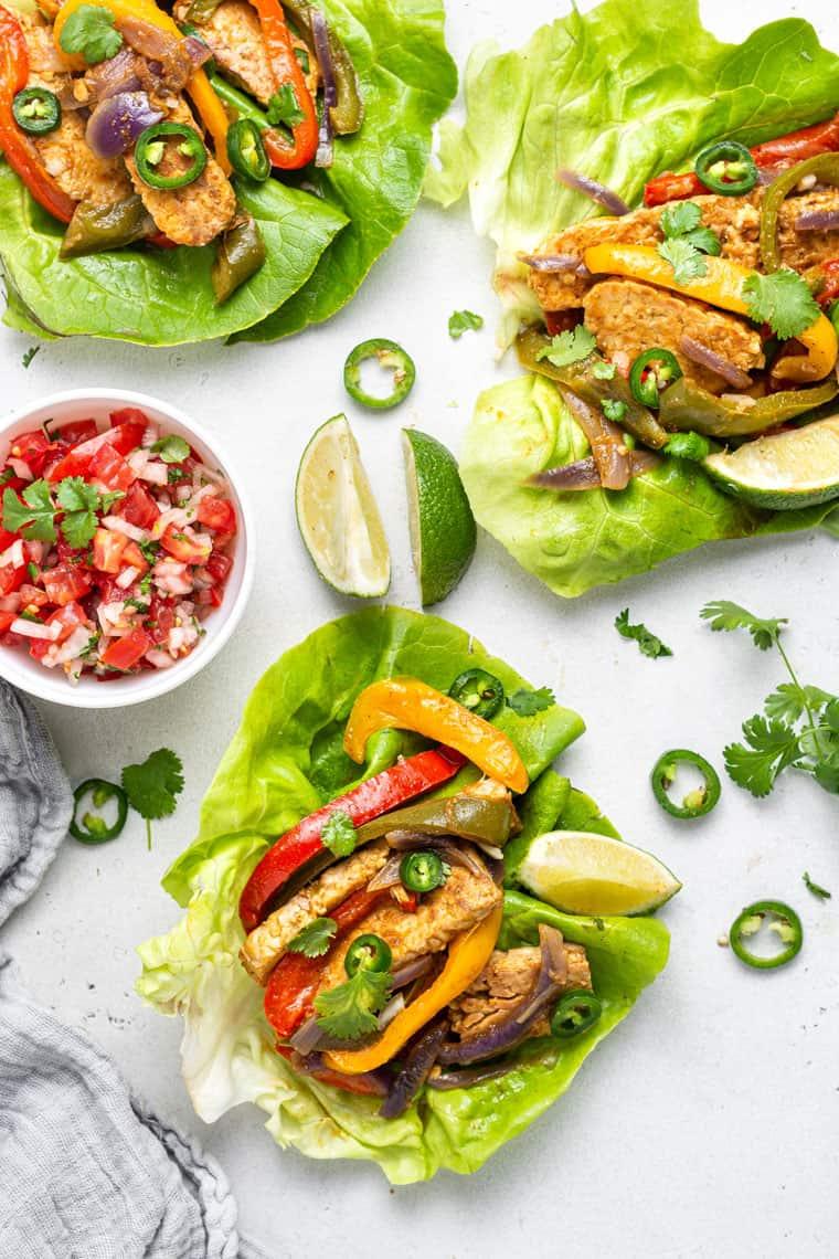 overhead of lettuce wraps with vegan tempeh fajita filling