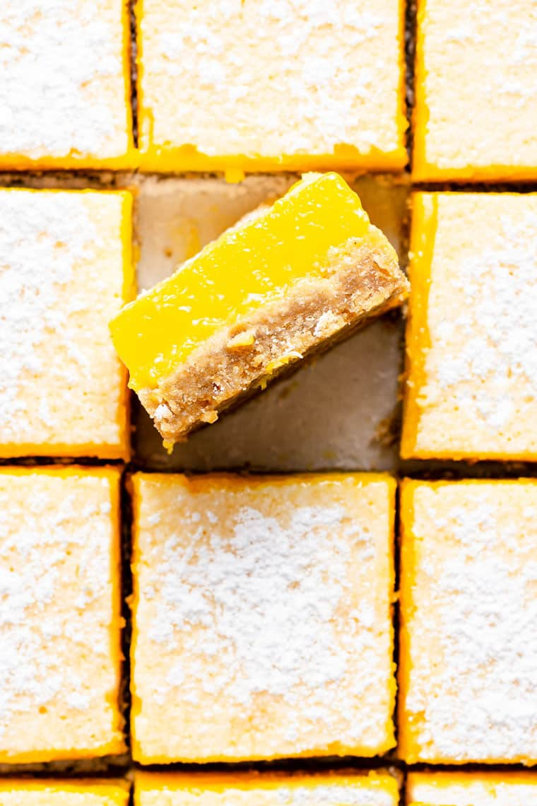 overhead of lemon bars with one turned on its side