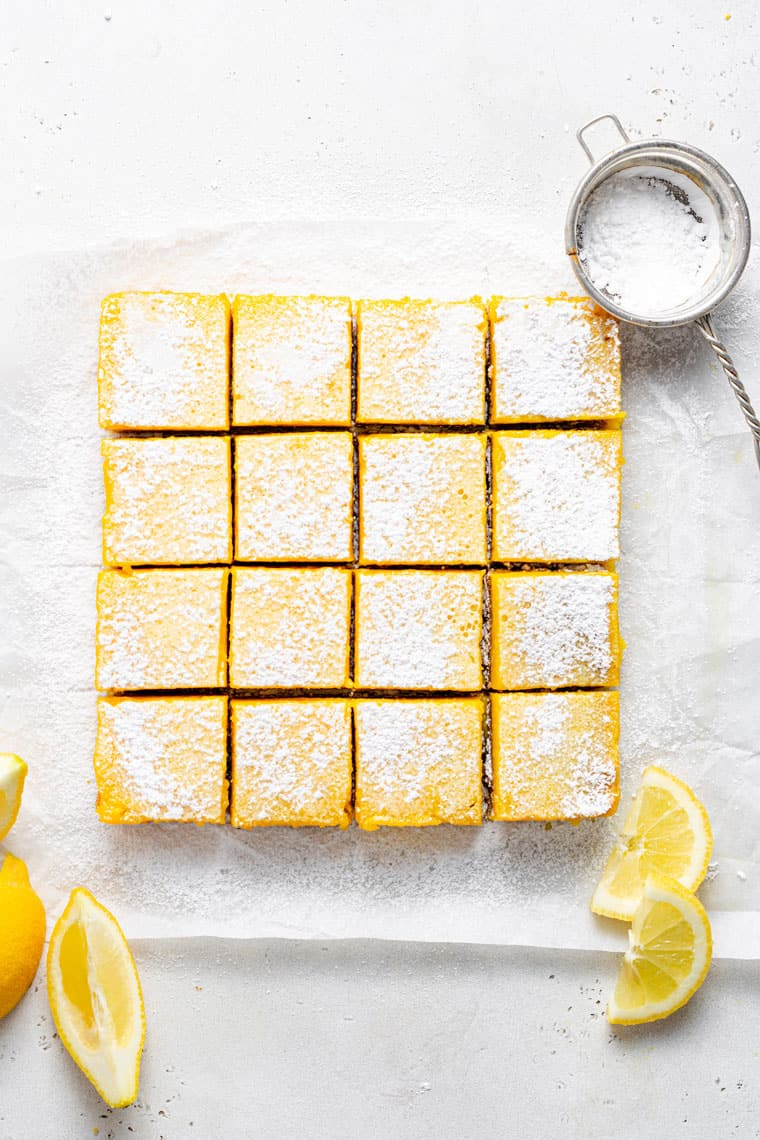 overhead of a tray of lemon bars topped with powdered sugar