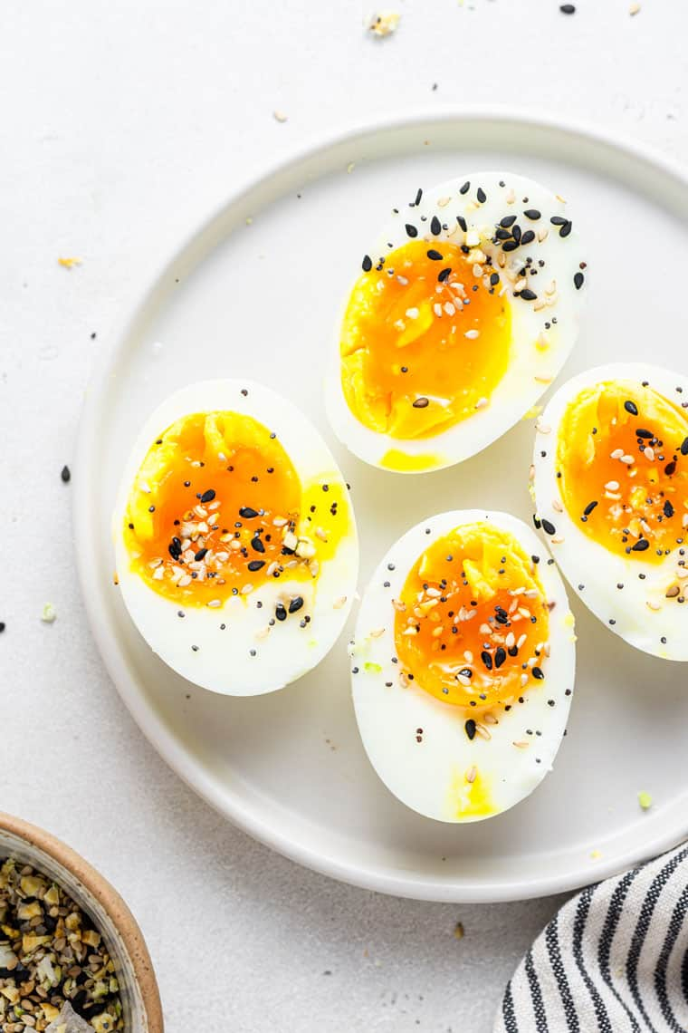 close up on a plate with jammy soft boiled eggs