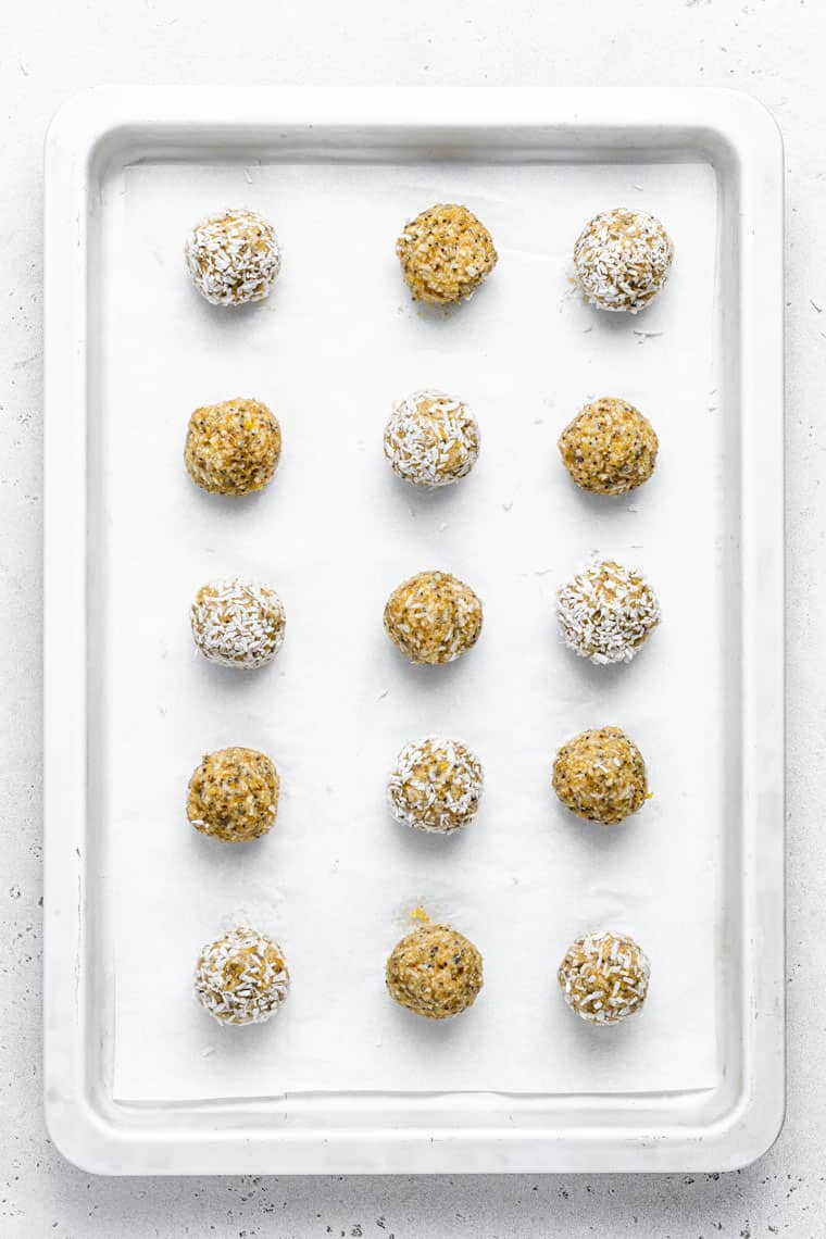 baking sheet with energy balls rolled in coconut