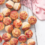 overhead shot of mini muffins with peanut butter and jelly on top