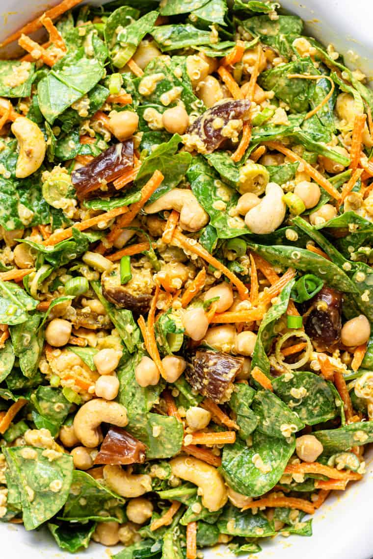 close up on details of chickpea quiona salad with spinach and dates