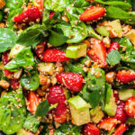 close up on strawberry salad with quinoa and spinach