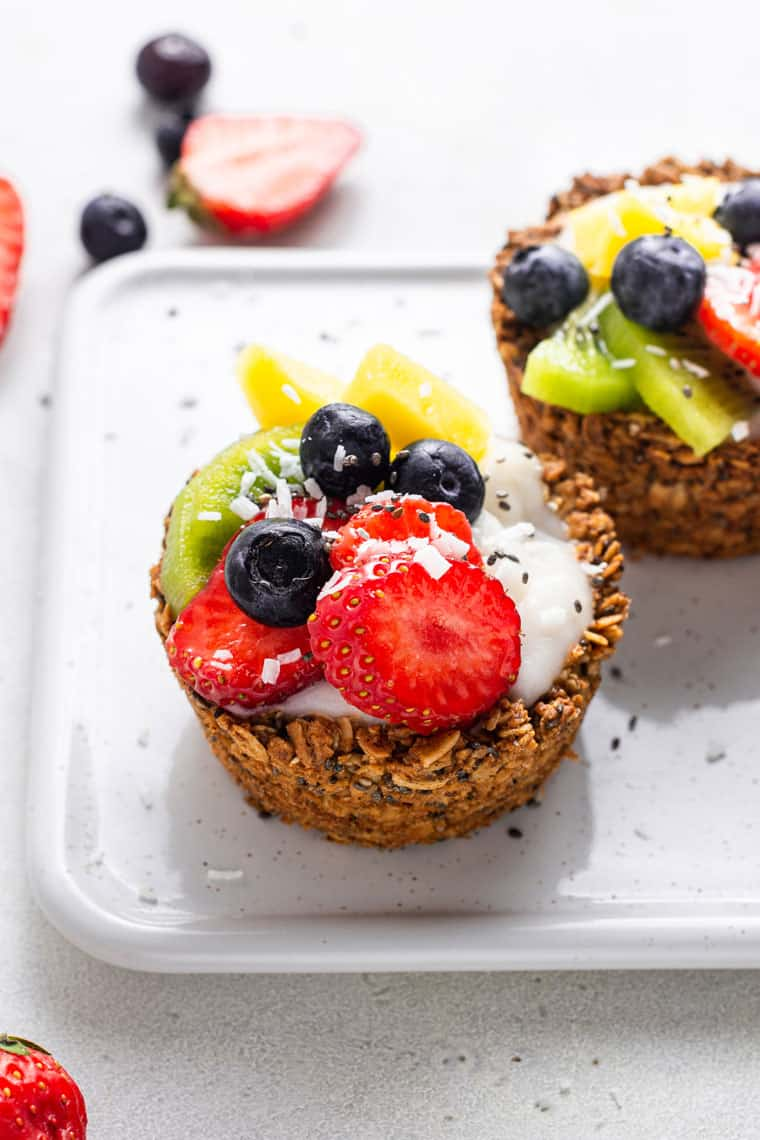close up on a granola cup with fresh berries and yogurt