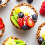 close up on an oatmeal cup with vegan yogurt and fresh berries
