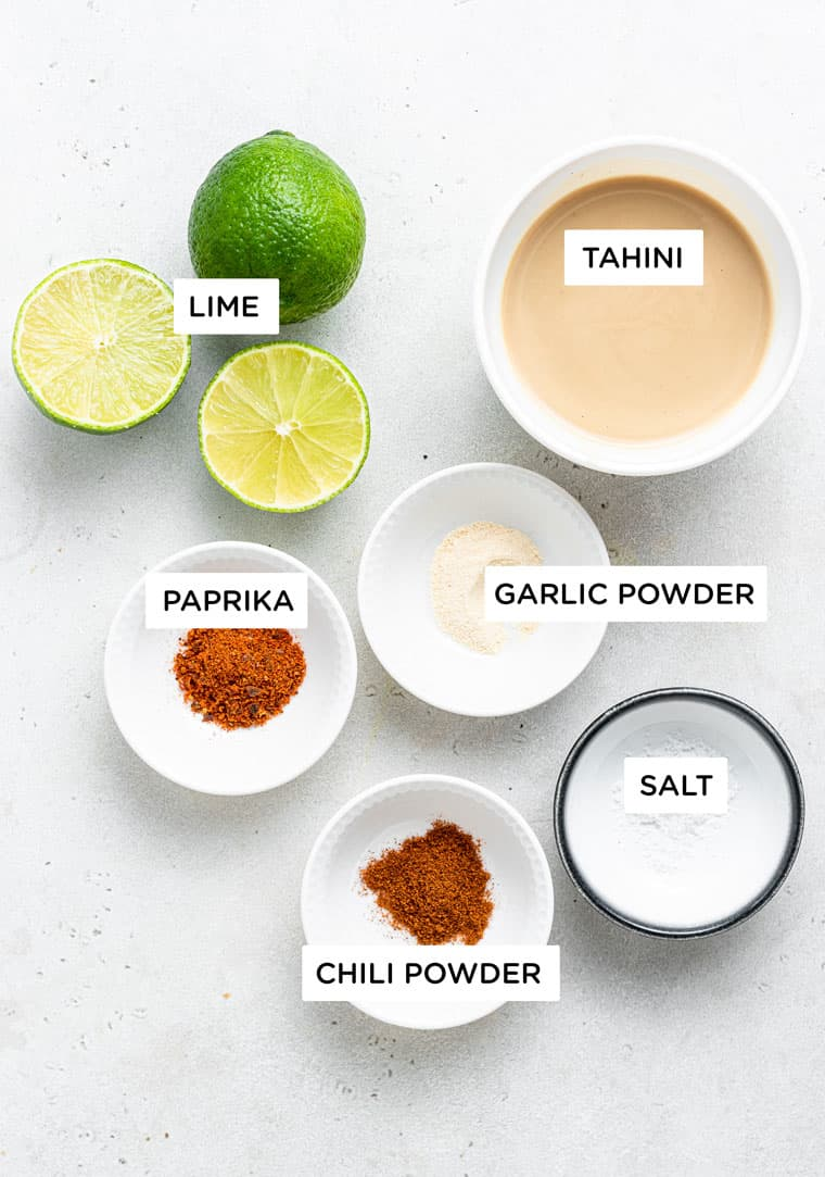 bowls of ingredients to make tahini sauce with lime and chili