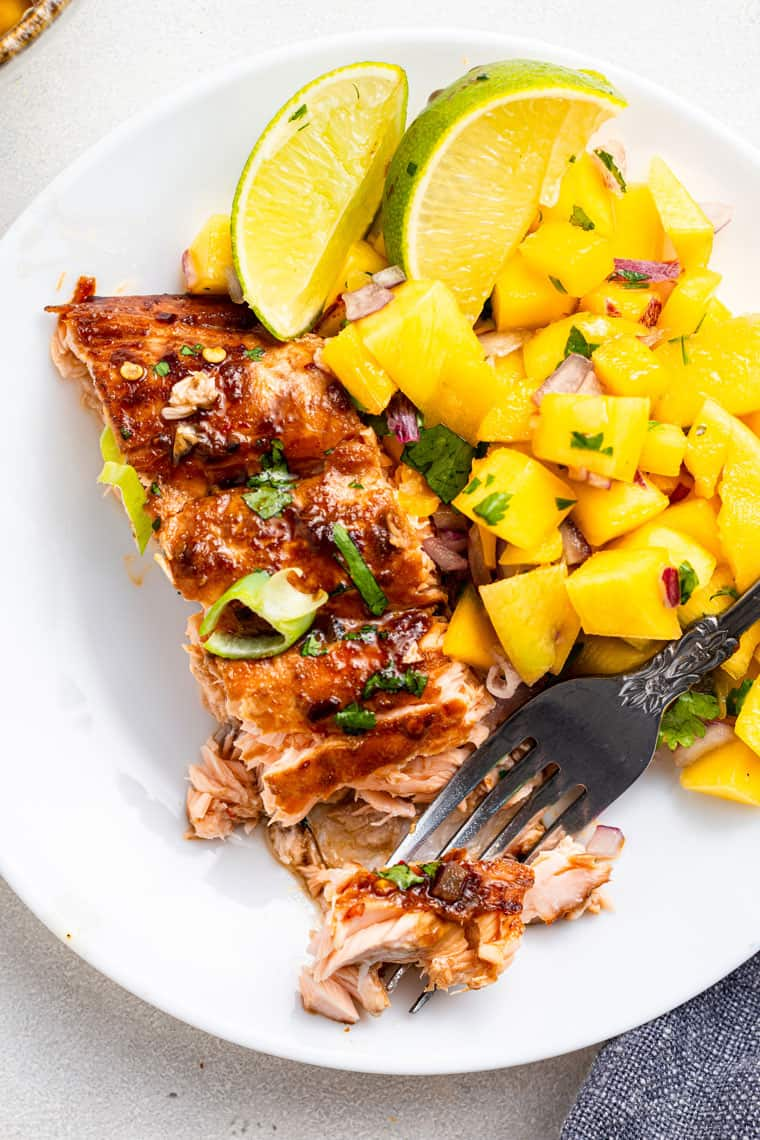 plate with a piece of salmon and mango salsa
