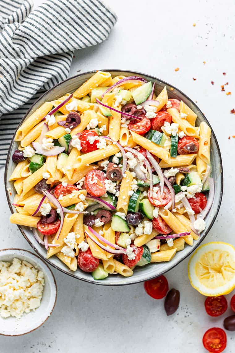 overhead of a bowl of colorful vegetarian pasta salad