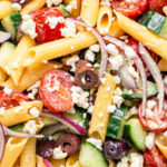 close up on pasta salad with vegetables and olives