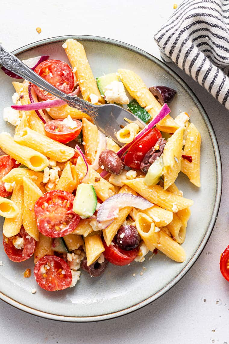 plate of pasta salad with summer vegetables and cheese