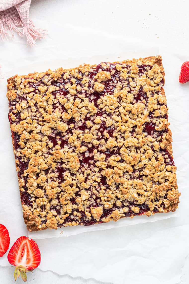 square of strawberry oat bars before slicing