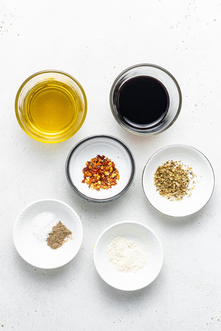 overhead of the ingredients for easy balsamic marinade in small bowls
