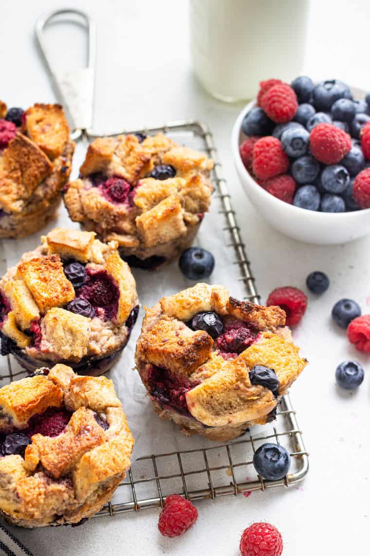wire rack wth french toast cups and fresh berries on top