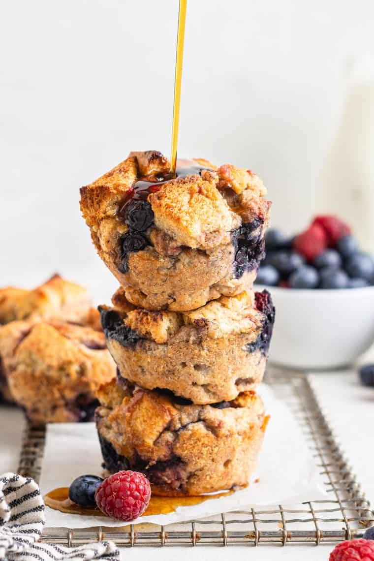 three french toast muffins stacked with syrup pouring over